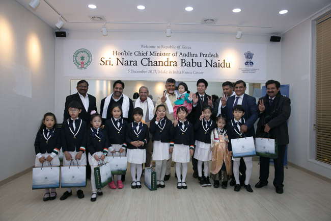 AP delegation with children at the Make India Korea Centre, Busan
