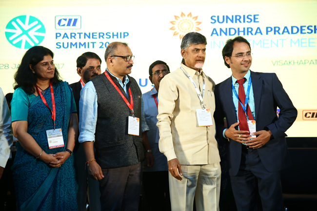 Exchanging MoUs at Partnership Summit-2017, Visakhapatnam